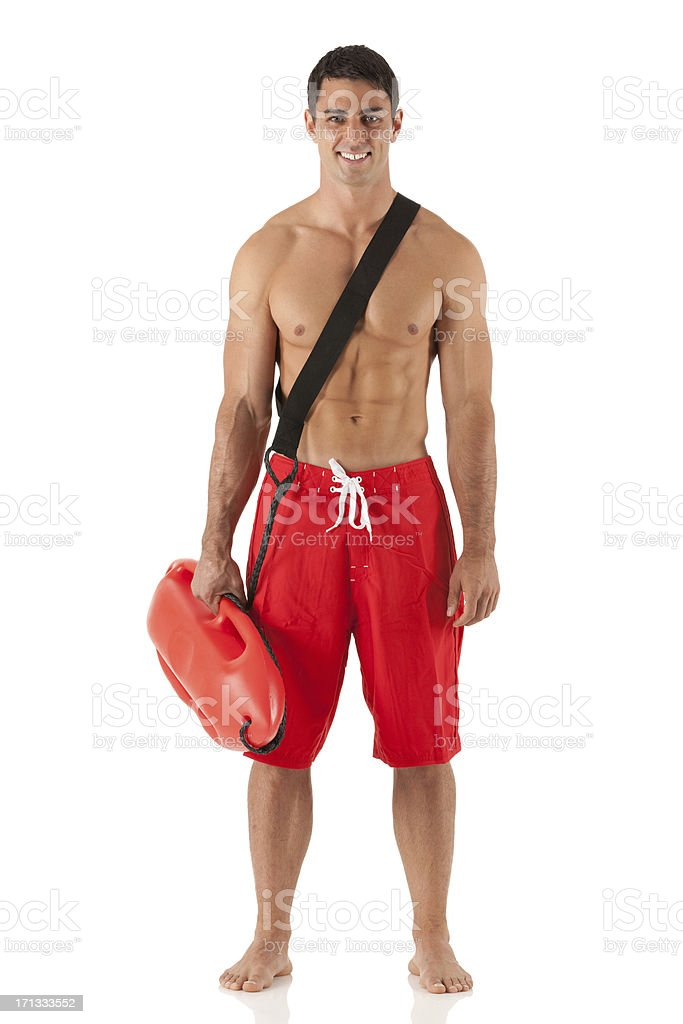 Attractive male lifeguard standing with a float royalty-free stock photo