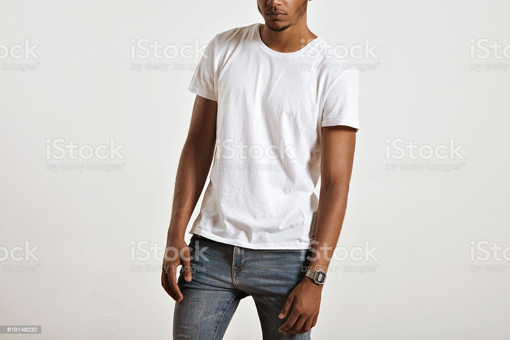 Attractive male model presenting blank white t-shirt stock photo