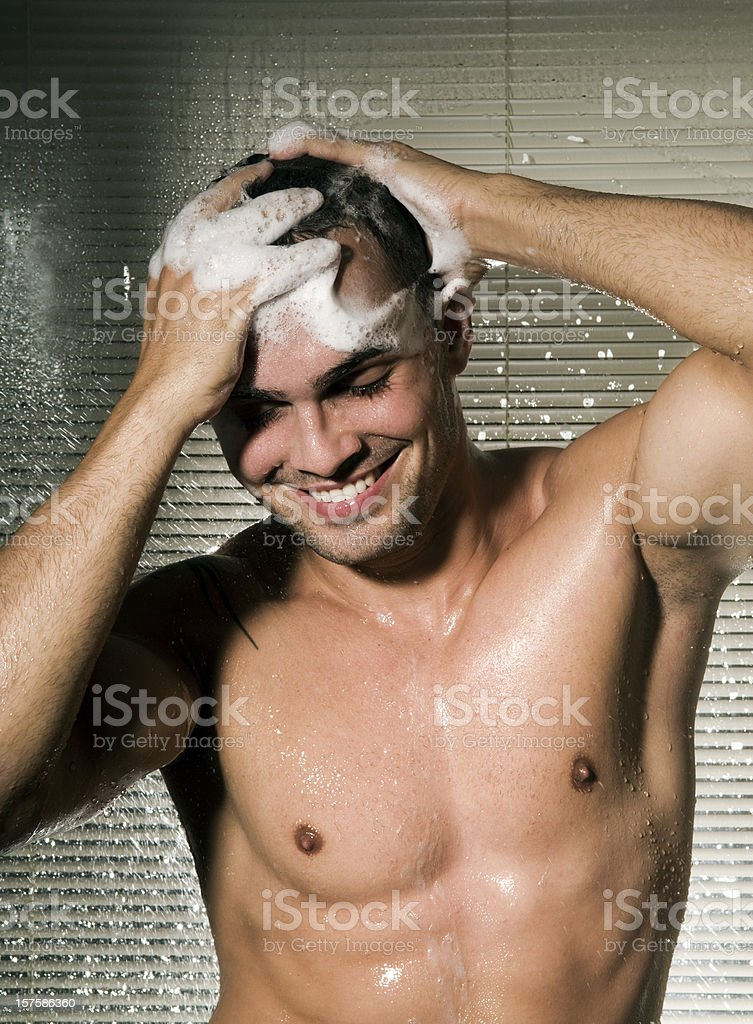 Attractive male taking shower royalty-free stock photo