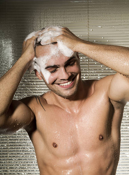 Attractive male taking shower