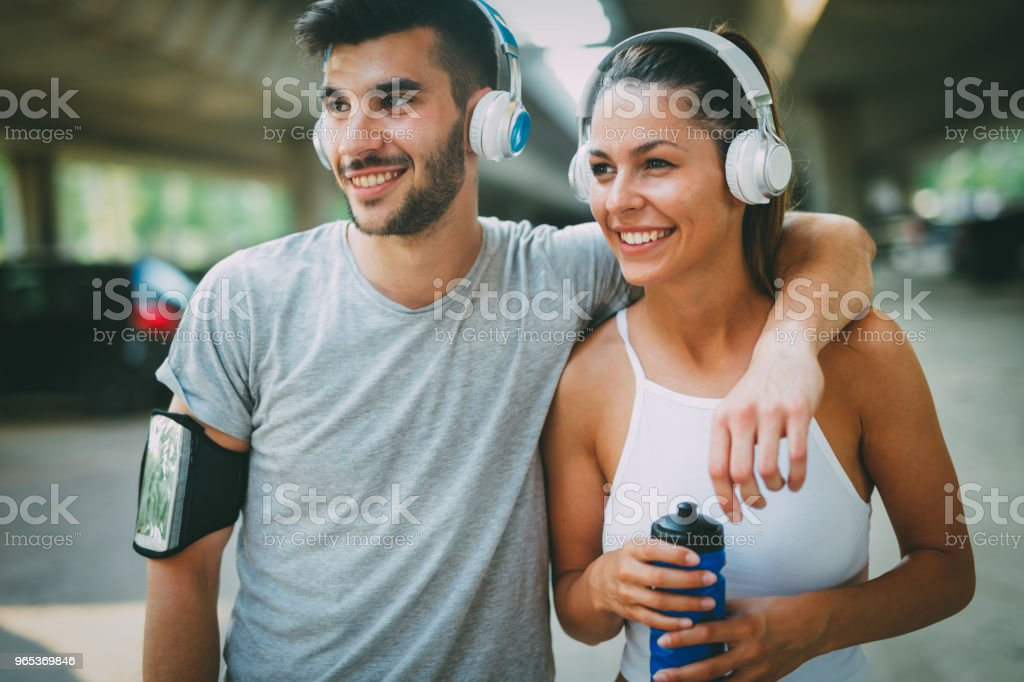 Attractive man and beautiful woman jogging together royalty-free stock photo