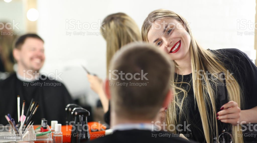 Attractive man came to hairdresser to makes stock photo