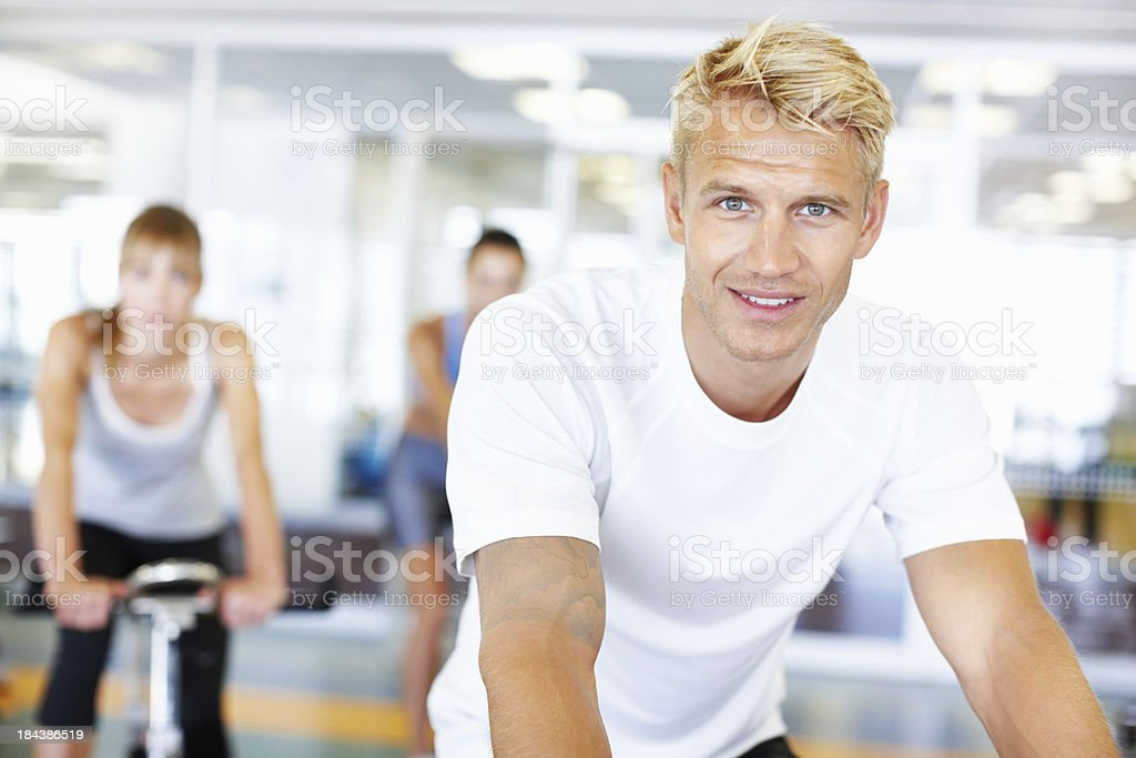Attractive man spinning in gym royalty-free stock photo