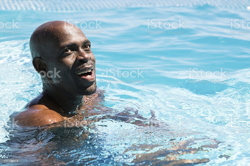 Attractive Man in a Swimming Pool stock photo