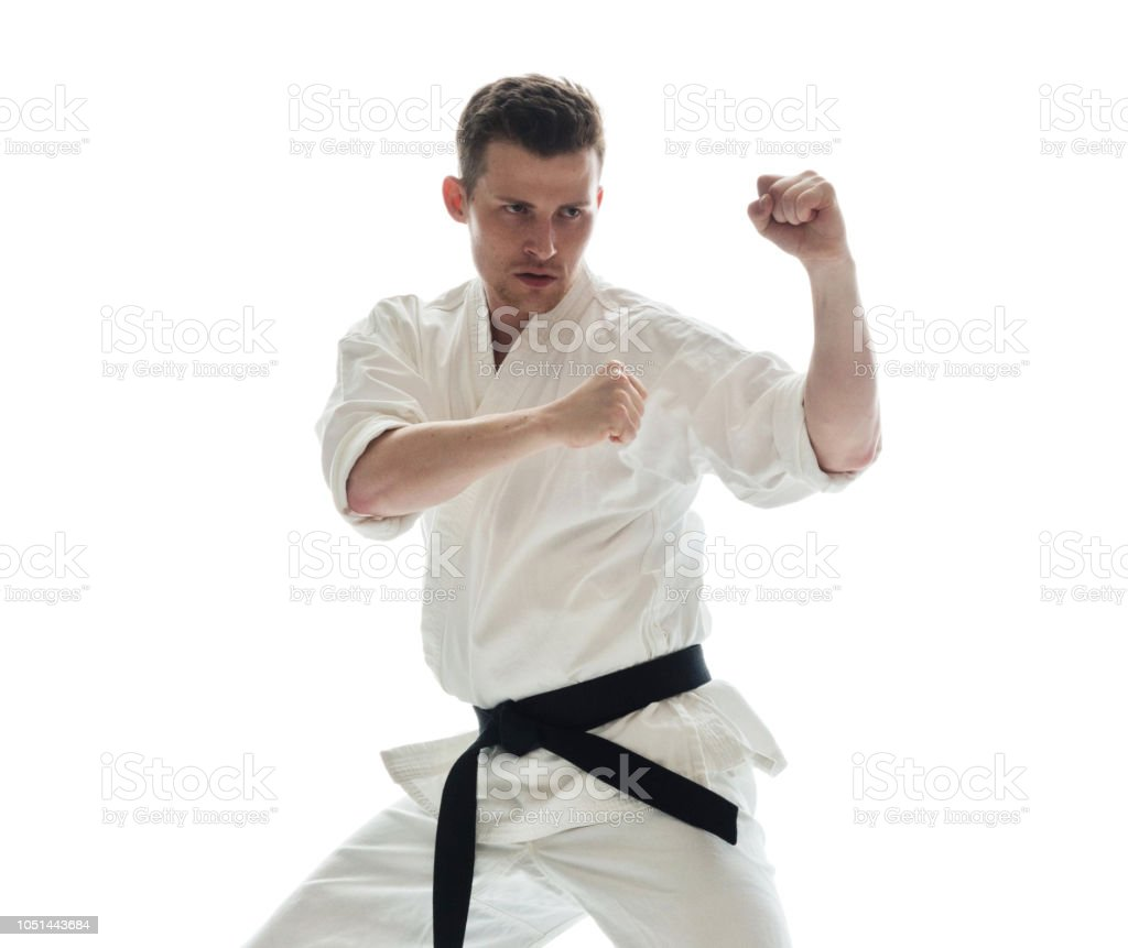 Attractive man in karate clothes stock photo