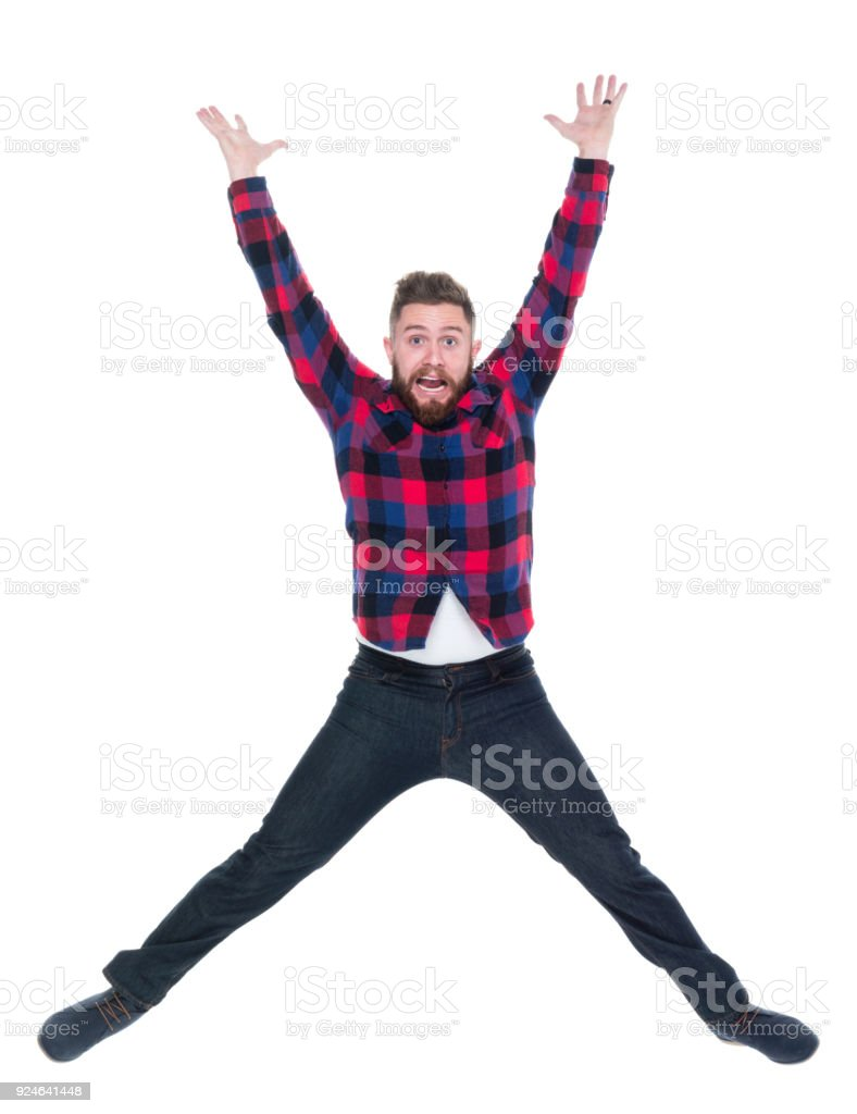 Attractive man in plaid shirt being active stock photo