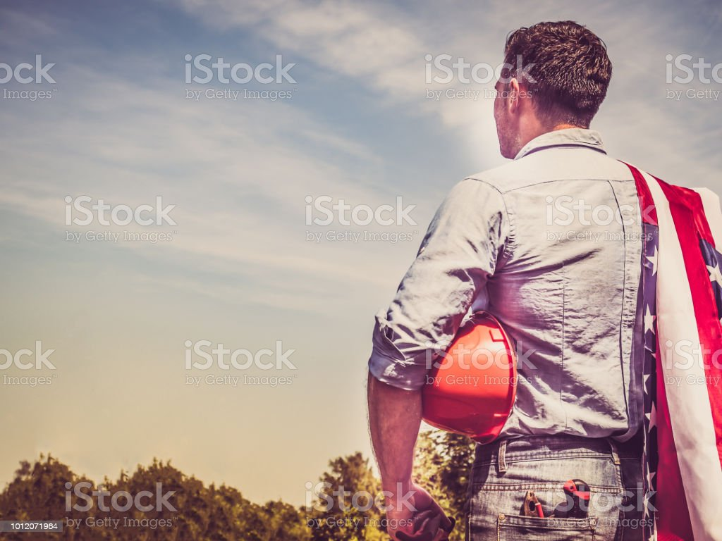 Attractive man in work clothes stock photo