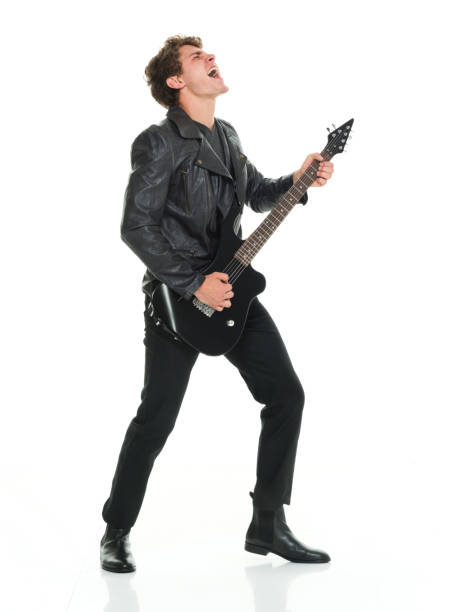 Attractive man playing electric guitar stock photo