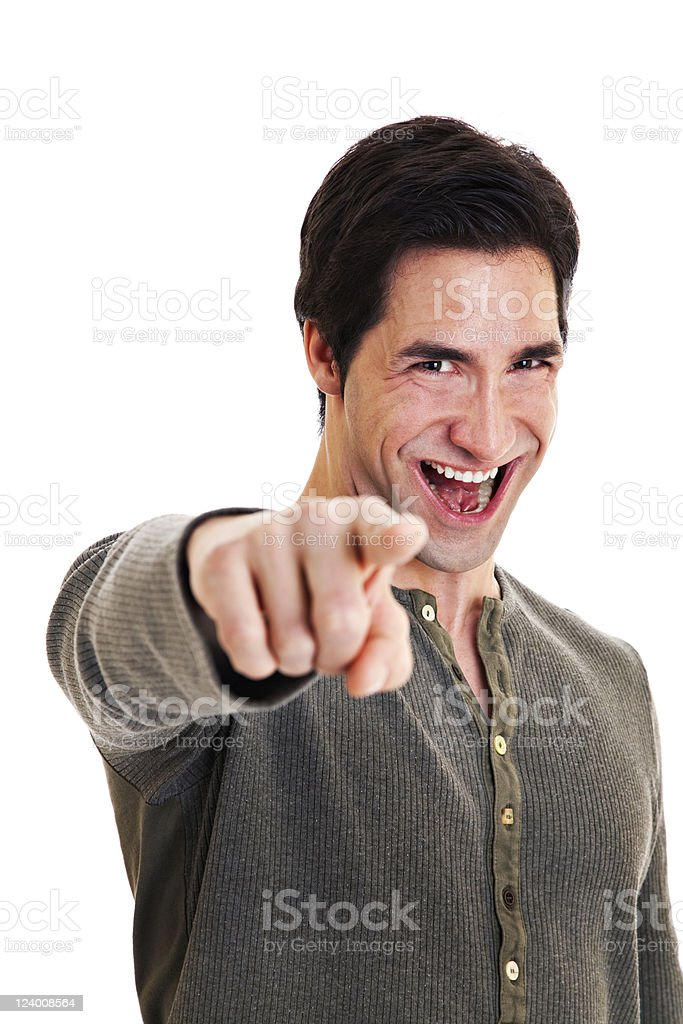 Attractive man points and laughs royalty-free stock photo