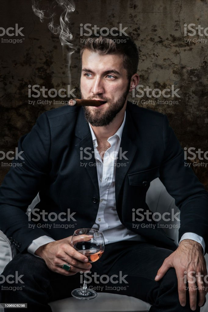 Attractive Man With A Cigar And A Drink Stock Photo