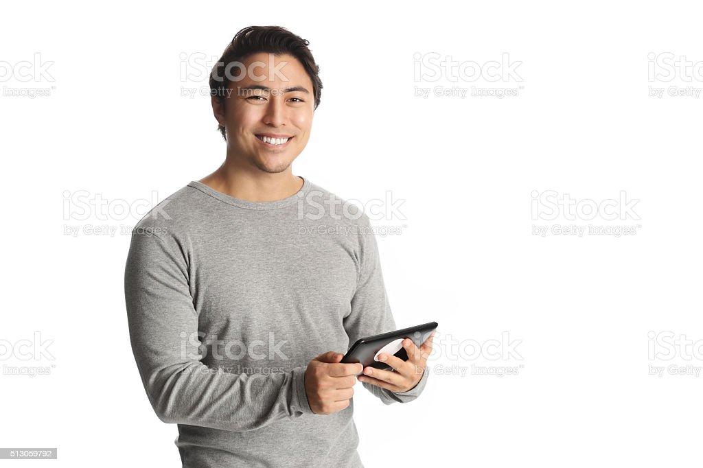 Attractive man with a digitalreader stock photo