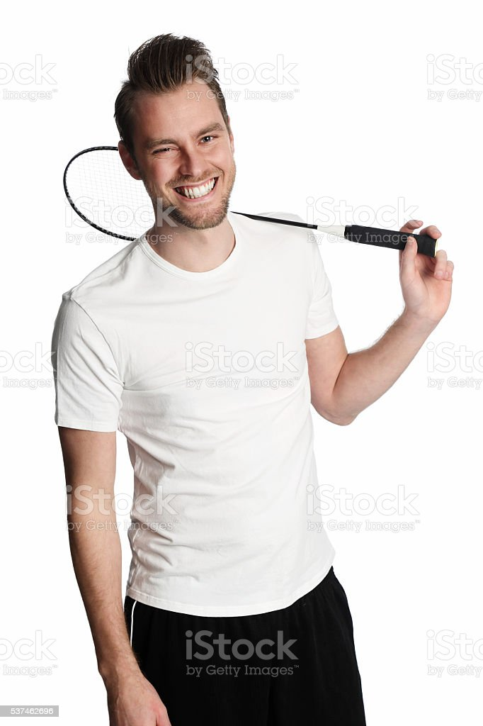 Attractive man with badminton racket - Photo