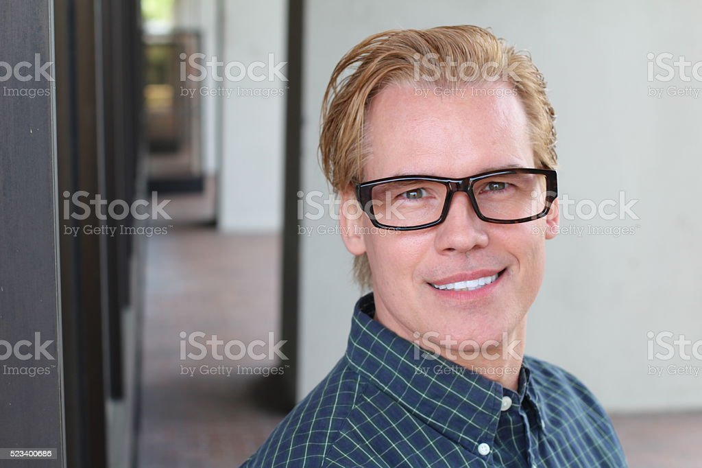 Attractive man with his hair colored blond stock photo