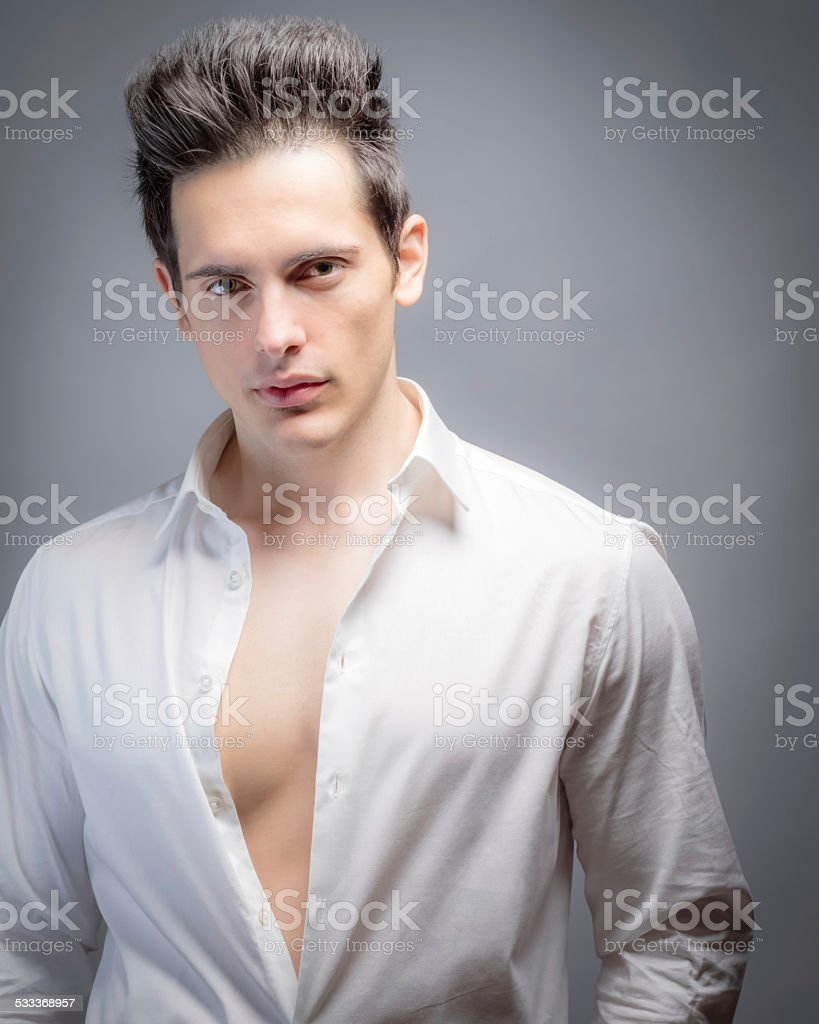 Attractive Man With Shirt Unbuttoned stock photo