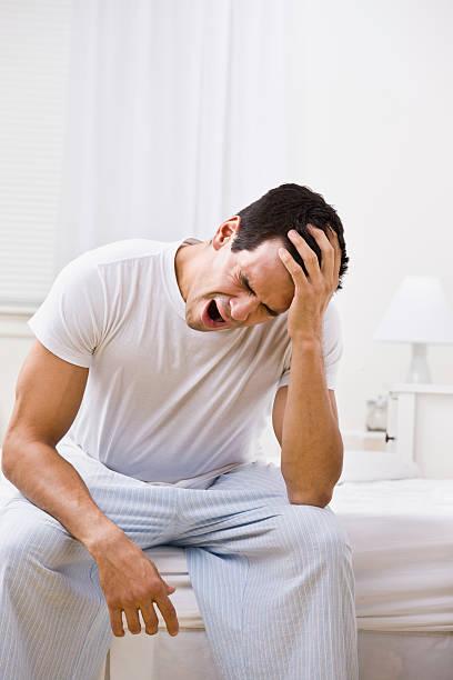Attractive Man Yawning and Looking Sleepy stock photo
