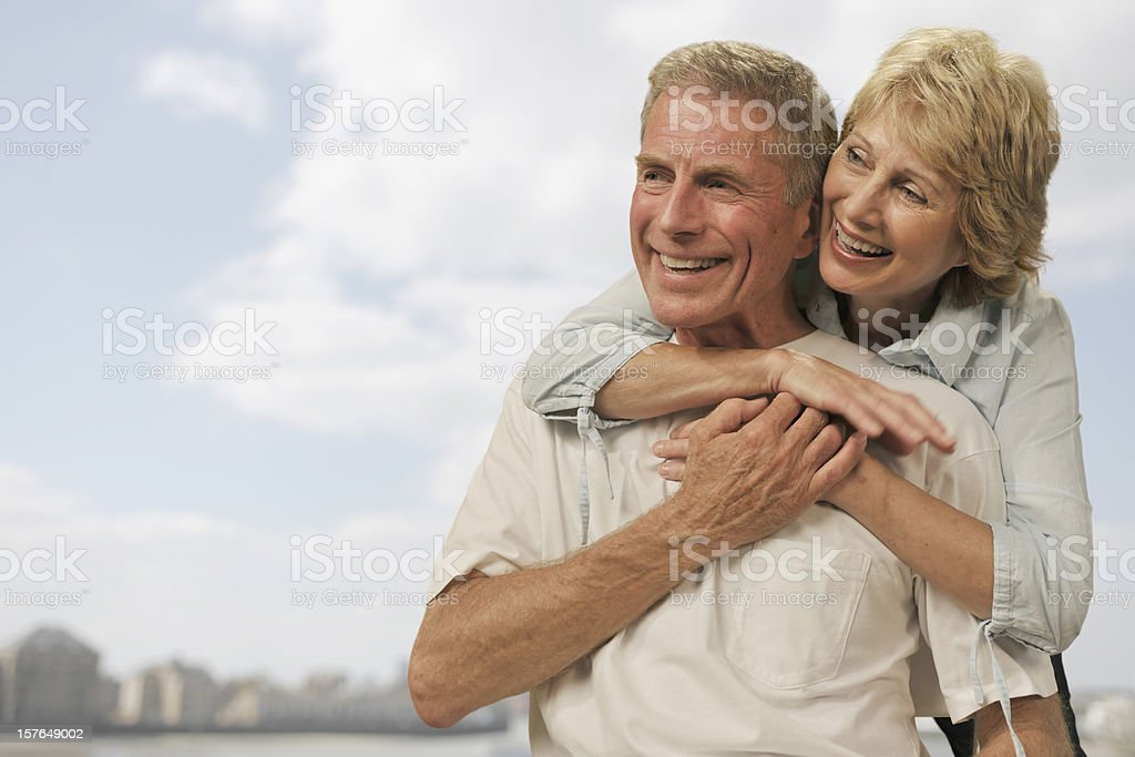 Attractive mature couple smiling and hugging. royalty-free stock photo