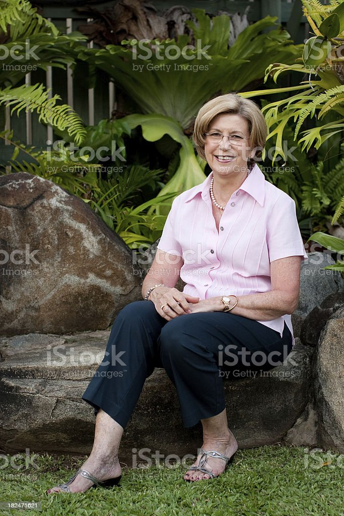 Attractive Mature Healthy Woman outdoors garden royalty-free stock photo