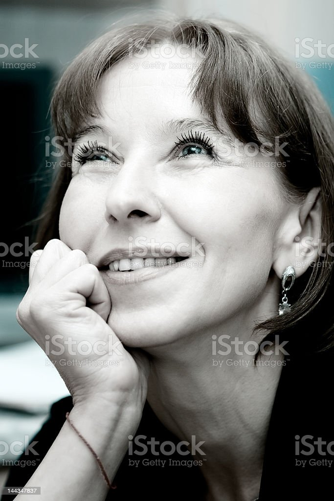 attractive mature woman dreaming royalty-free stock photo