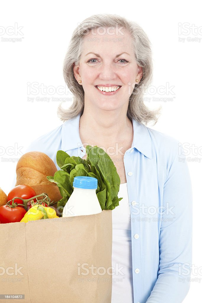 Attractive Mature Woman Holding a Bag of Groceries royalty-free stock photo
