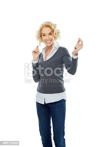 1173001813istockphoto Attractive mature woman looking happy on white 489125503