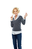 istock Attractive mature woman looking happy on white 489125503