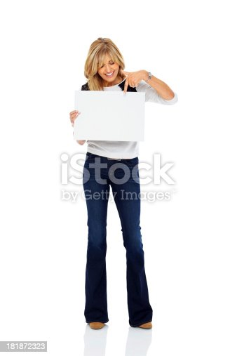 157609352 istock photo Attractive mature woman pointing at blank billboard 181872323