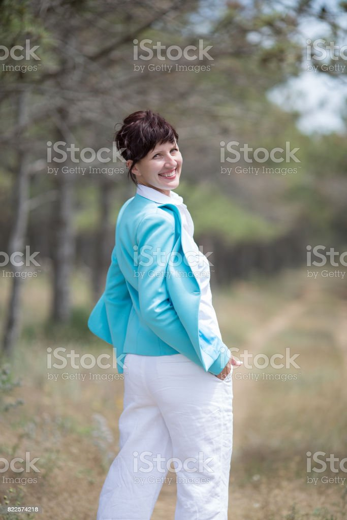 Attractive mature woman posing outdoors stock photo
