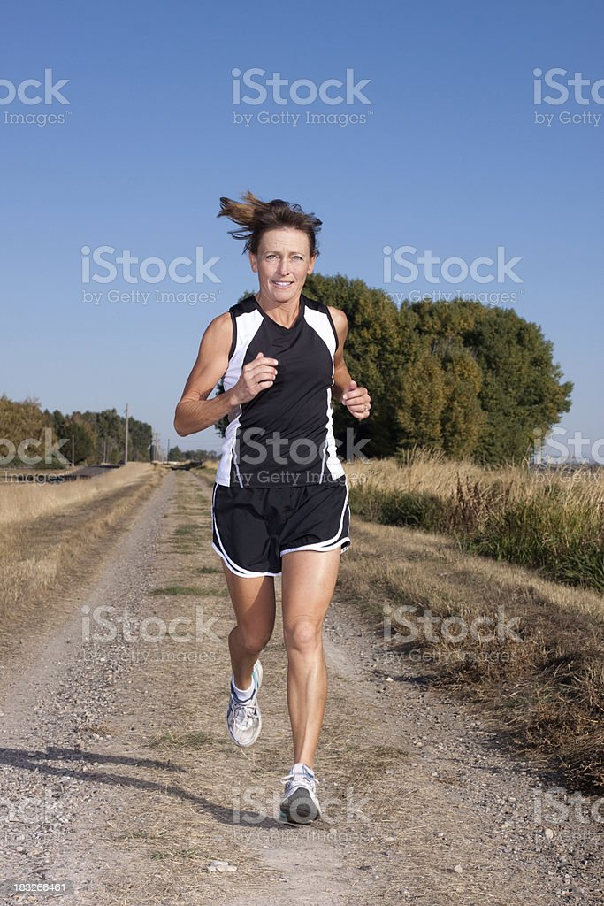 Attractive Mature Woman Running Outdoors royalty-free stock photo