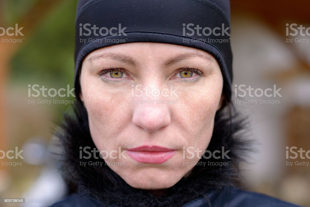 Attractive mature woman staring at the camera stock photo