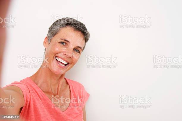 Attractive middle age woman smiling and taking selfie picture id939808922?b=1&k=6&m=939808922&s=612x612&h=ohrq6iw1ormrs8v78mwqqcdq9uhzjckn9c0bp9plsnu=