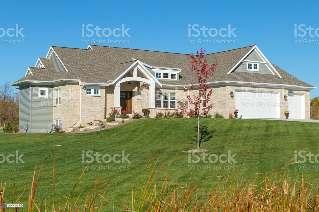 Attractive Mixed Materials Ranch Style Home stock photo