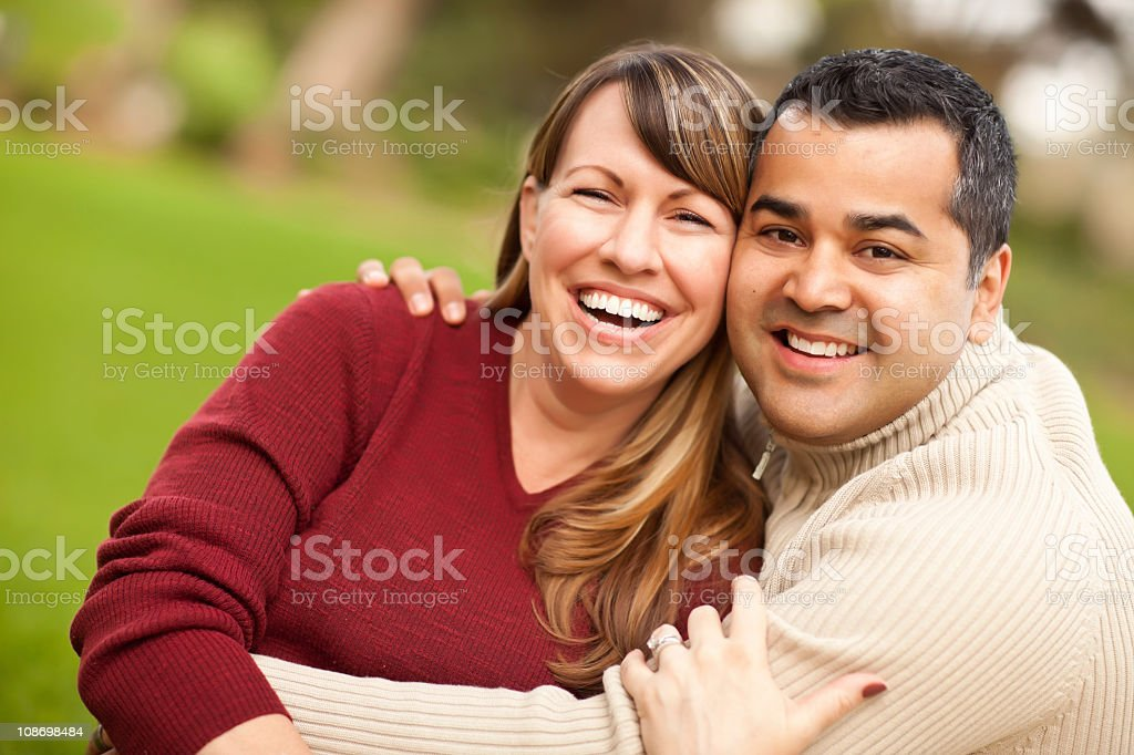 Attractive mixed race couple smiling for a portrait stock photo