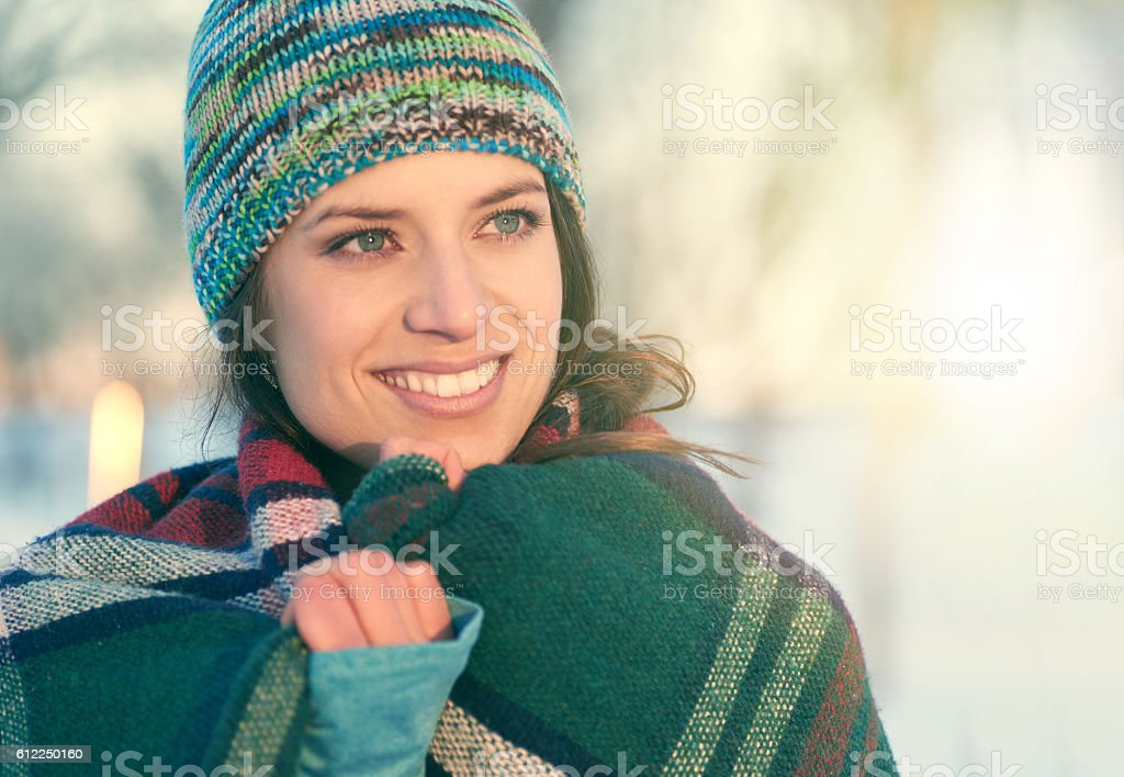 Attractive mixed race woman smilling in the snow stock photo