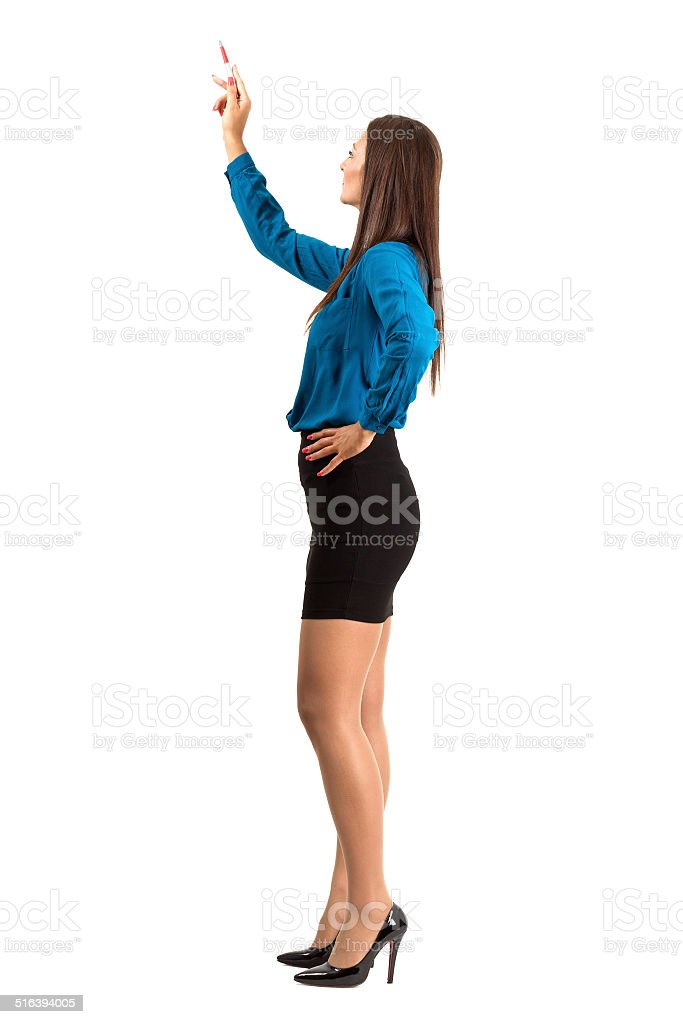 Attractive modern business woman pointing with pencil stok fotoğrafı