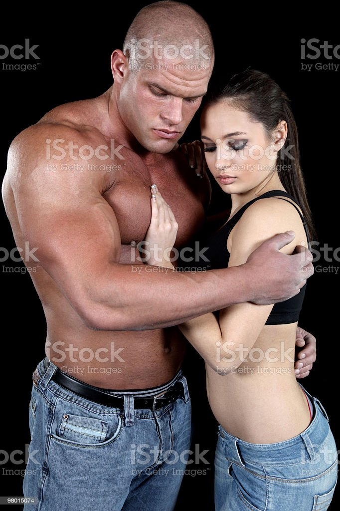 Attractive muscular couple in love royalty-free stock photo