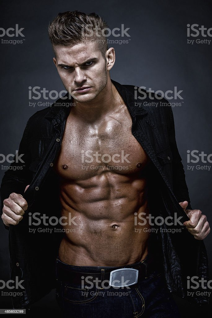 Attractive muscular man standing stock photo