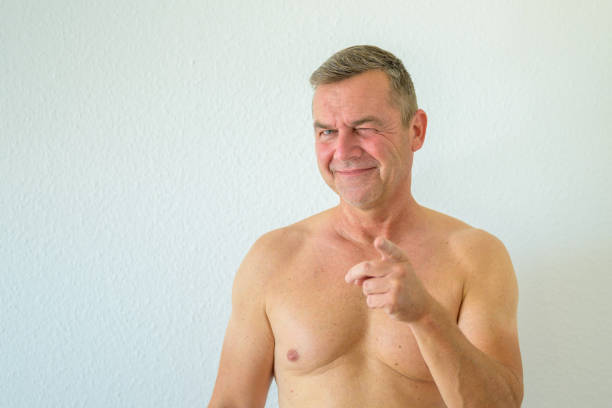 Attractive muscular shirtless man pointing stock photo