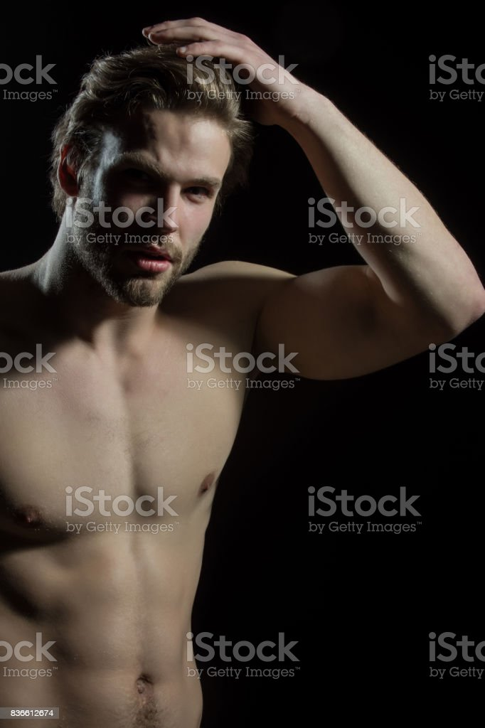 Sexy closeup portrait of handsome topless male model with