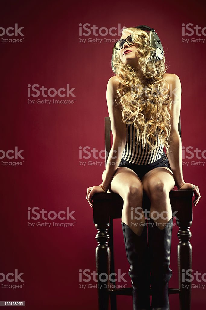 Attractive Nerd Woman Listening to Music royalty-free stock photo