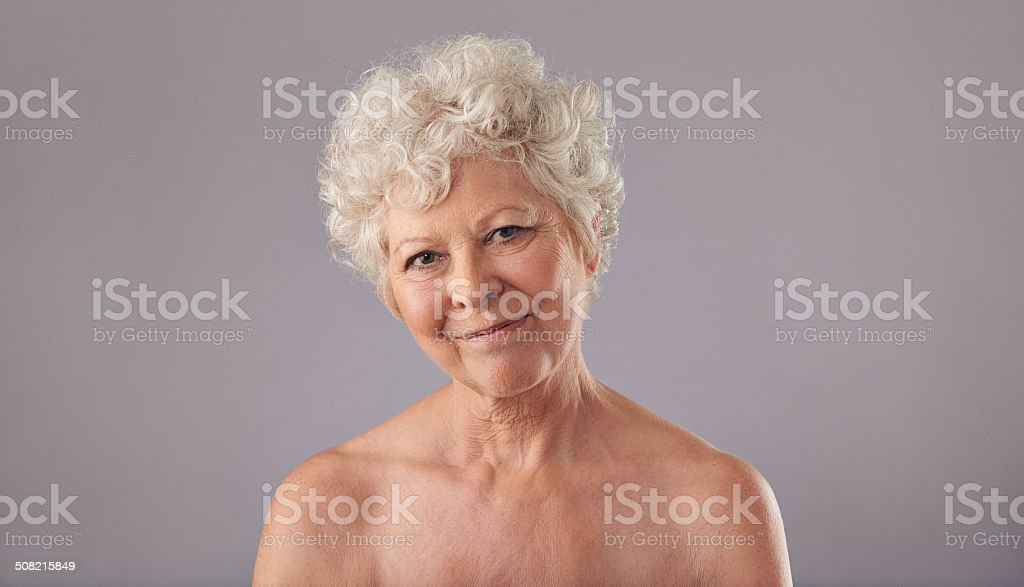 Attractive Old Woman Looking Happy Stock Photo