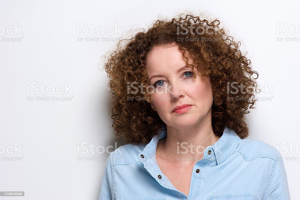 Attractive older woman with curly hair stock photo