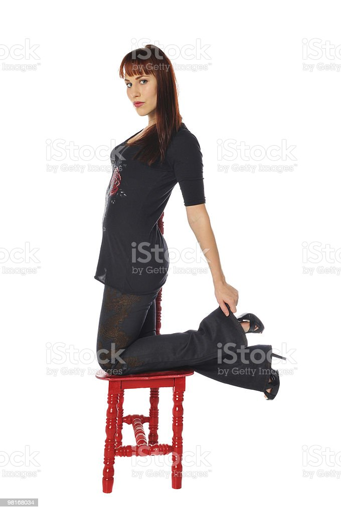 attractive owman with a red chair royalty-free stock photo