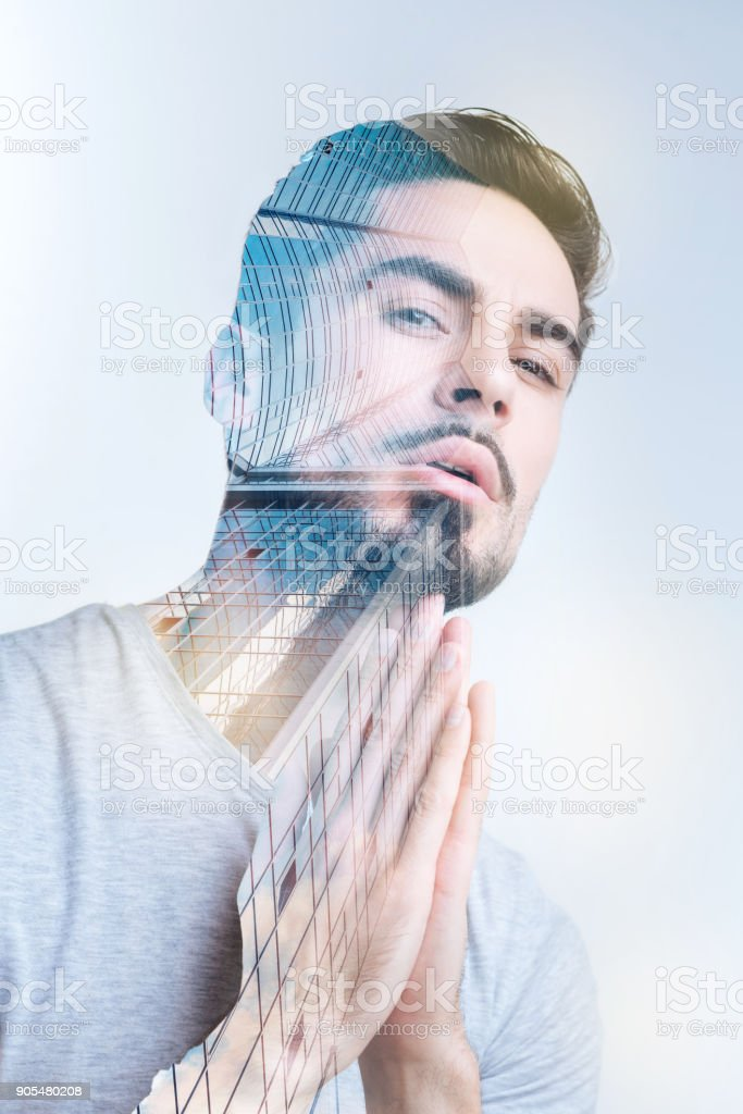 Attractive pensive man wants better life stock photo
