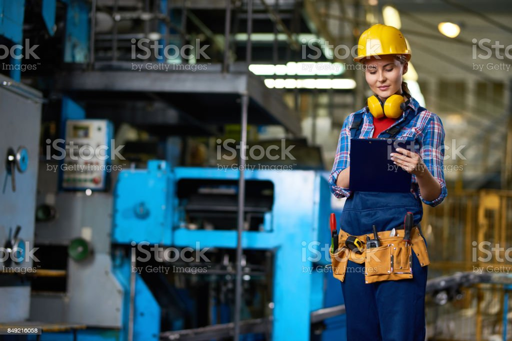 Attractive Plant Worker with Clipboard stock photo