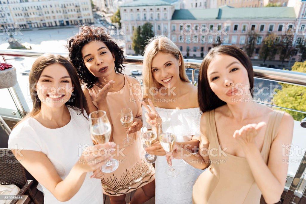 Attractive pleasant women sending you a kiss stock photo