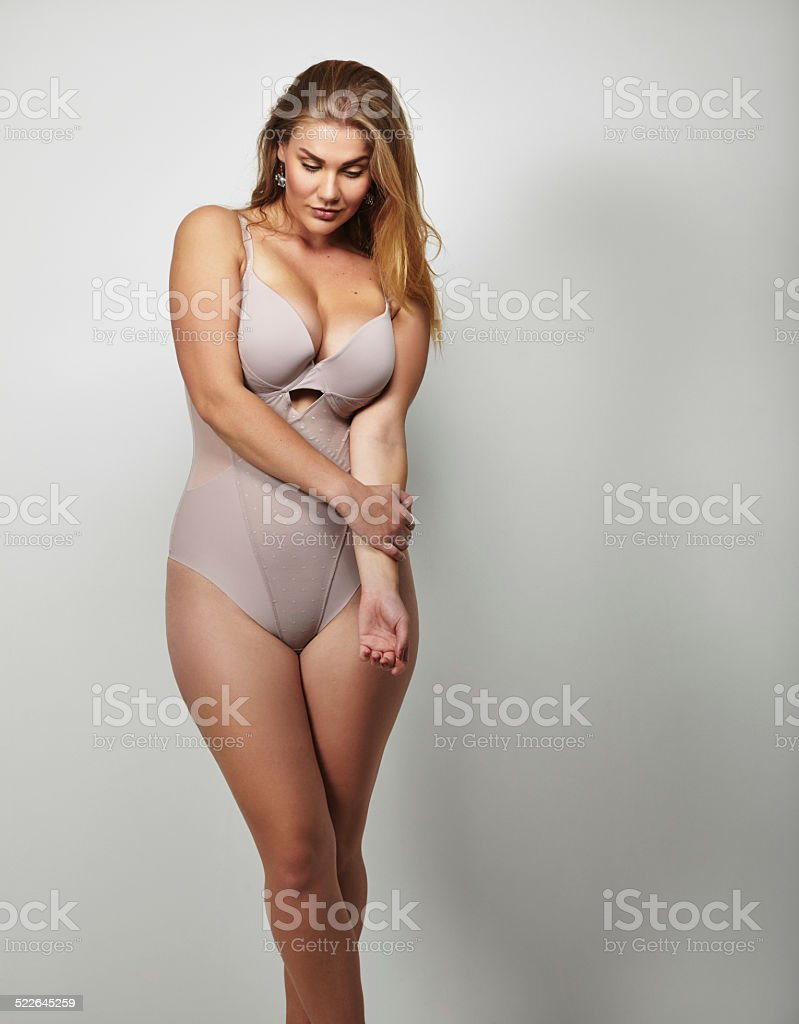Attractive plus size young lady in body stocking stock photo
