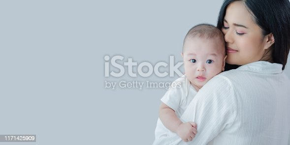 1049923194 istock photo Attractive Portrait Asian mother carrying baby boy with copy space panoramic banner,Happy Asian family healthcare love together with kid,mother's day concept 1171425909