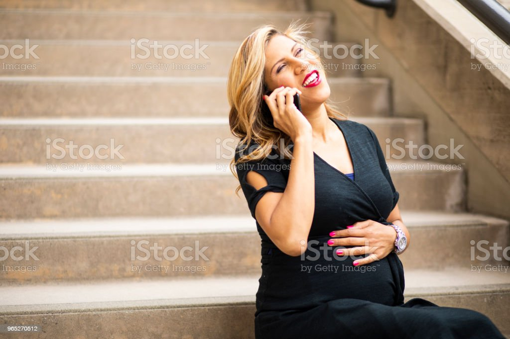Attractive Pregnant Hispanic Businesswoman using Smartphone zbiór zdjęć royalty-free