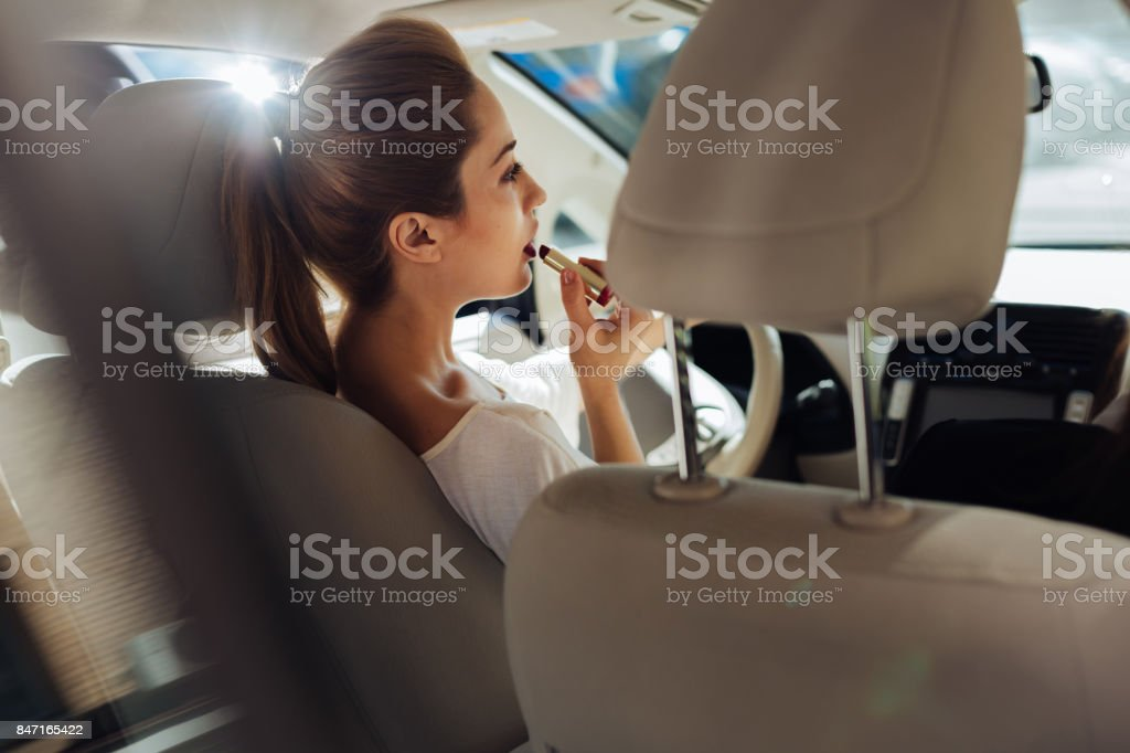Attractive pretty woman sitting behind the wheel stock photo