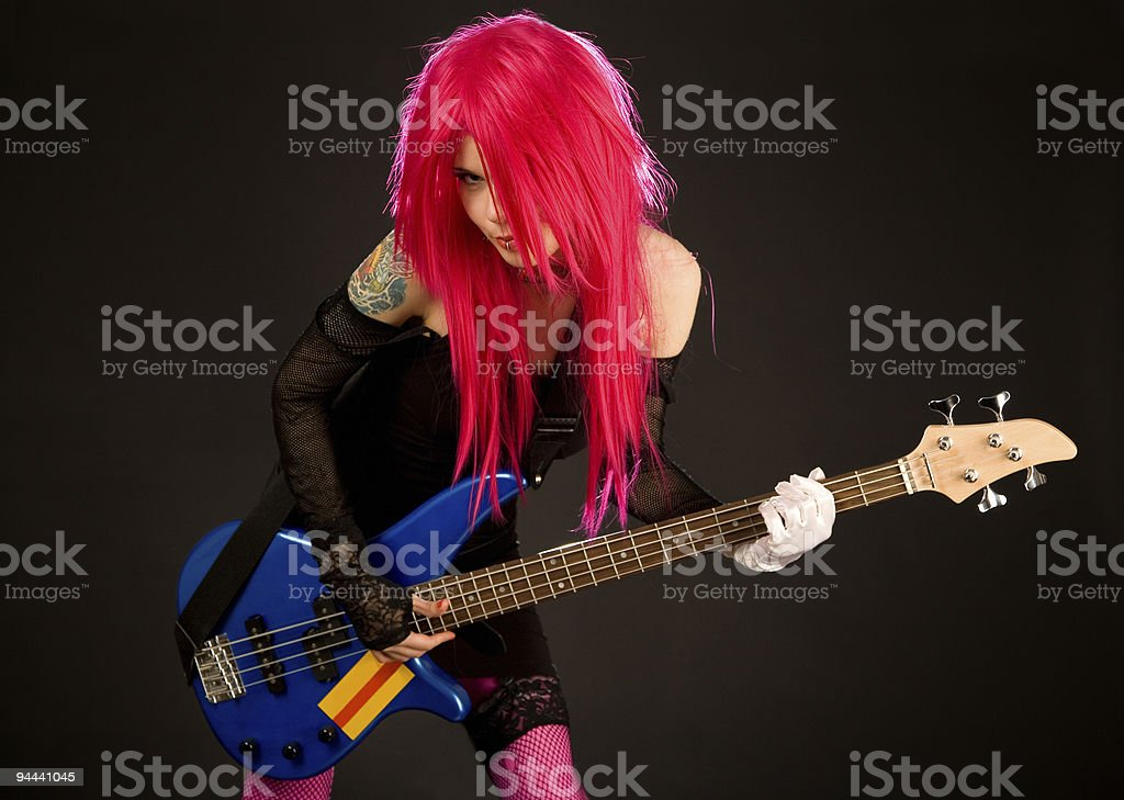 Attractive punk girl with bass guitar royalty-free stock photo